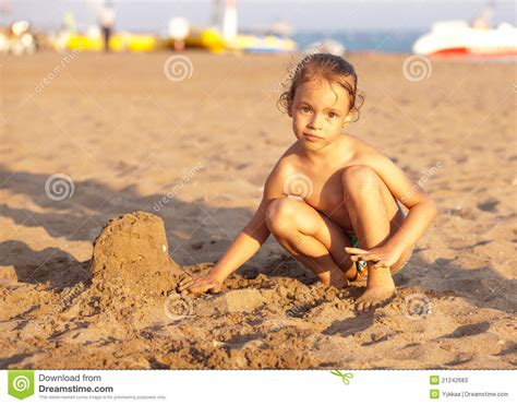 child   beach playing  sand stock image image