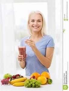 Smiling Woman Drinking Fruit Shake At Home Stock Photo ...