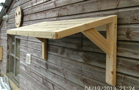 timber front door canopy porch bespoke hand  porch