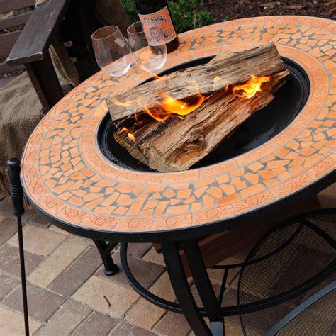 spanish sun terra cotta mosaic    fire pit  hayneedle