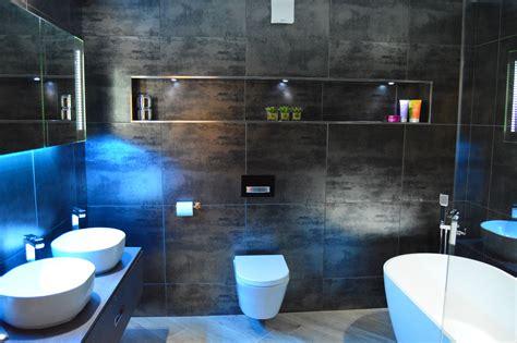 contemporary black metallic bathroom with led mood
