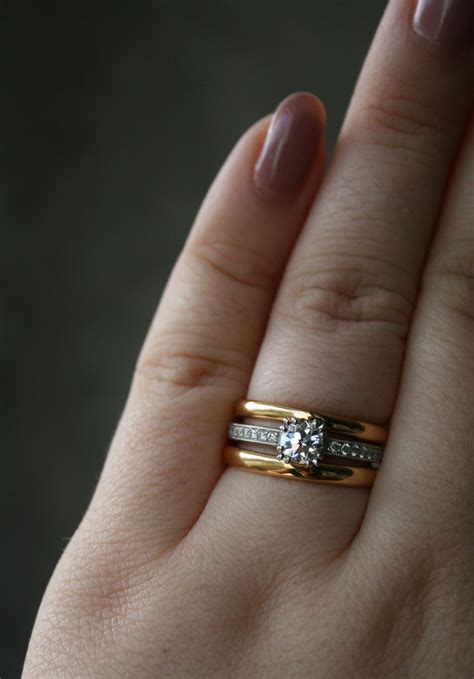 show me your white metal solitaire with yellow or rose gold diamond wedding band