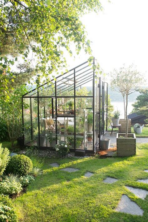 modern greenhouse a greenhouse in iron ellen hodt of corniche interior design she often suggests a greenhouse or