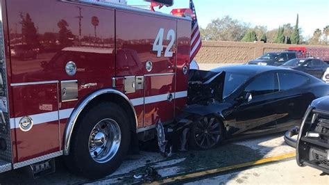 Tesla Crashes Into Parked Fire Truck, Autopilot Being