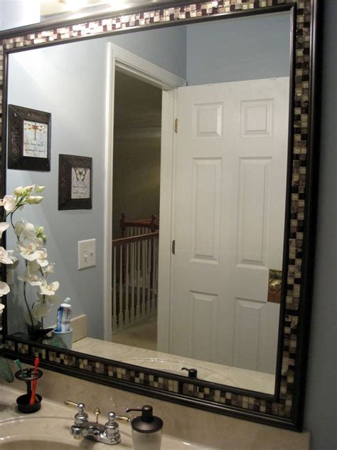 Framing Bathroom Mirrors Diy by Diy Frame A Bathroom Mirror With Molding Tile Master
