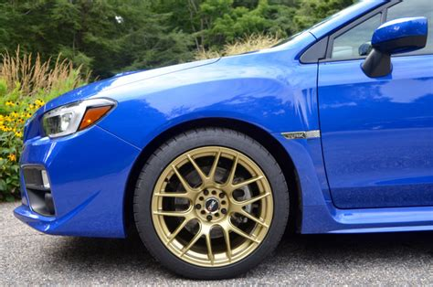 blue subaru gold rims world rally blue with gold wheels