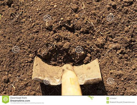 Horizontal Shovel In Dirt Royalty Free Stock Photography