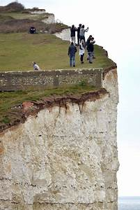 Sightseers still taking pictures on Seven Sisters cliffs ...