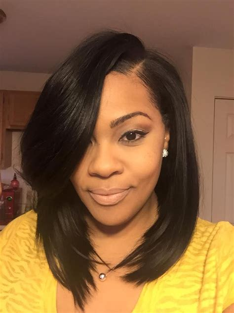 Medium Sew In Hairstyles by Mid Length Angled Bob With Heavy Feathered Sew In