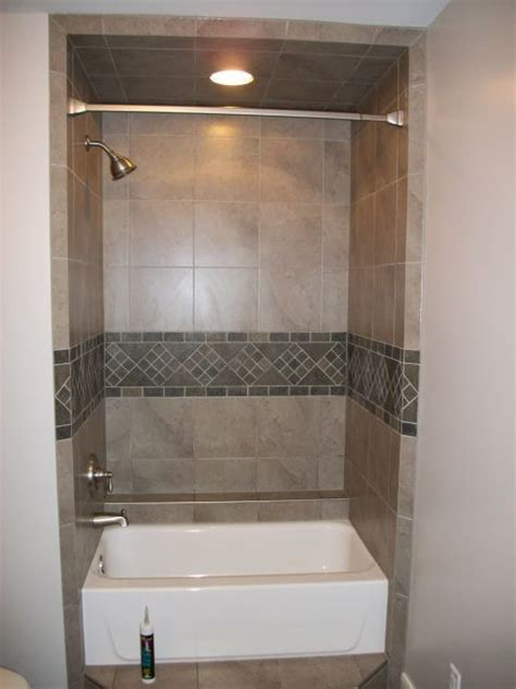 Tiling A Bathtub Alcove by Alcove Tub Shower With Deco Band Traditional Bathroom