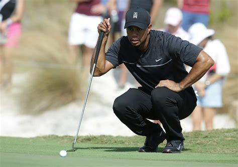 GOLF: Tiger Woods returns with mixed bag and a 73