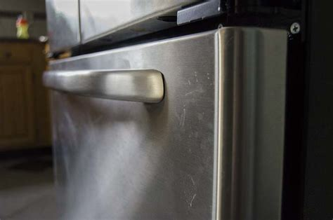 clean stainless steel appliances  baby oil