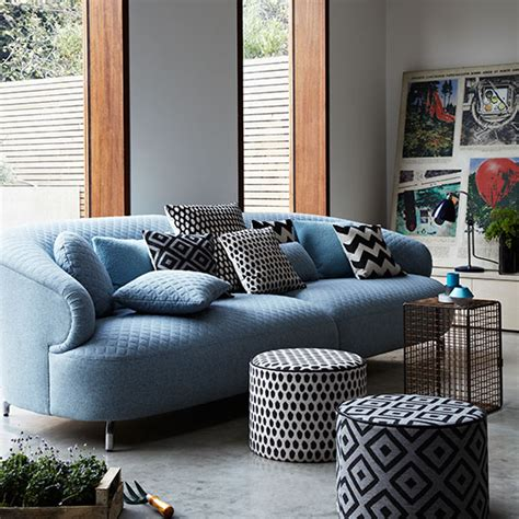Decorating With A Blue Sofa by Modern Living Room With Blue Sofa And Poufs Decorating