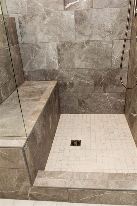 carbon gray tiled shower  bench  white square tile