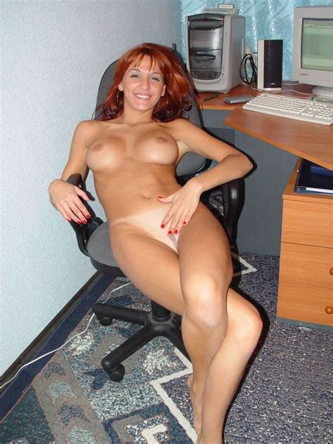 Redhead And Cheerful Secretary Posing Naked At Work Place