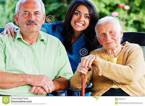 alzhaimer tuin nurse with elderly people stock image image 33049171