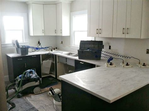 cost of corian danks and honey kitchen renovation solid surface