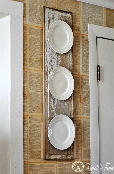 chippy wood  vintage plates wall display beautiful vintage plates  repurposed