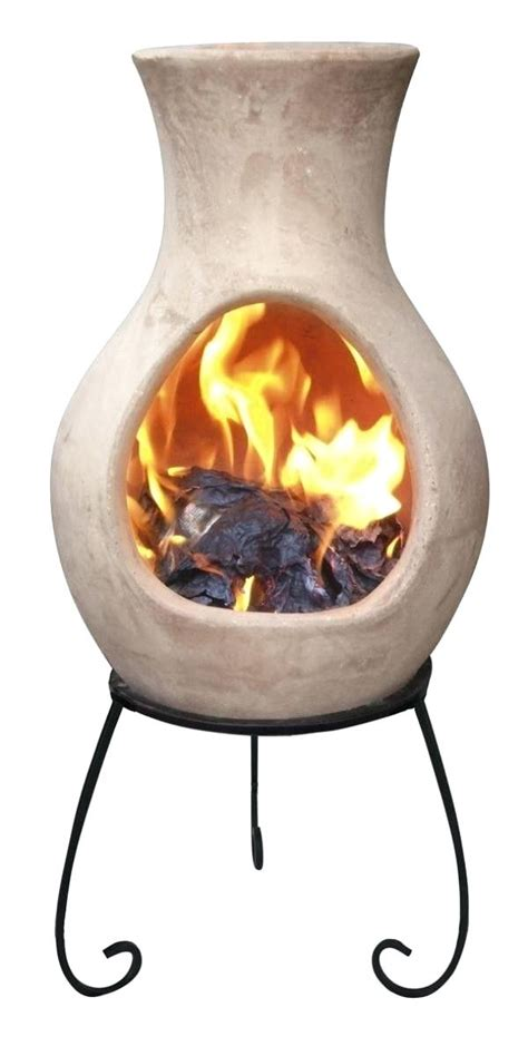 A chiminea is a free standing front loading fireplace or oven with a bulbous body and usually a vertical smoke vent or chimney. Chiminea Fire Pit Menards Clay Outdoor ... in 2020 | Chiminea, Clay chiminea