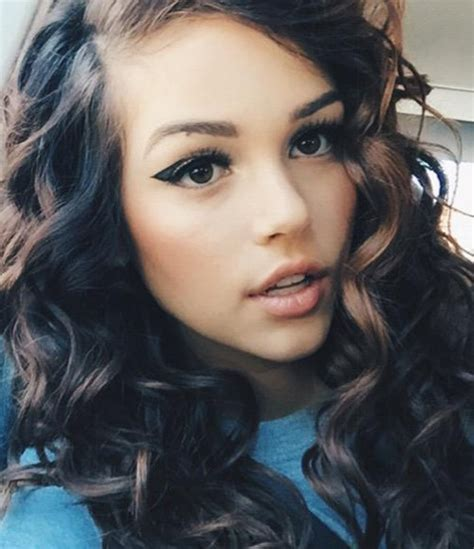 maggie lindemann wavy dark brown barrel curls peek  boo