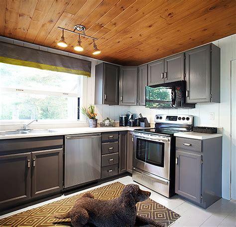 wood wall kitchen white paneled walls wood paneled ceiling painted hardwood floors w dark painted cabinets