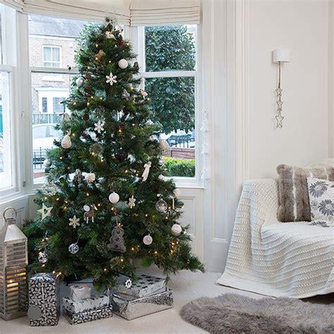 christmas tree living room snow white living room with christmas tree in bay housetohome co uk