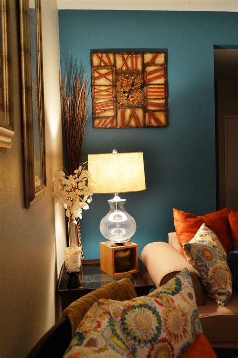 Living Room Decor With Orange Walls by Teal Accent Wall Side Table And Teal Accent Wall