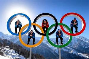 Athletes in the rings of the Olympic Games in Sochi ...