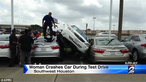 woman test drives toyota camry  crashes  car