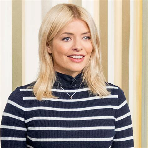 Holly Willoughby wears blue bow trimmed top by GOAT and ...