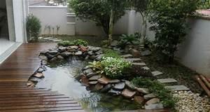 idees de bassin de jardin pour dynamiser votre exterieur With ordinary idee deco jardin avec cailloux 8 parterre de fleur avec cailloux obasinc