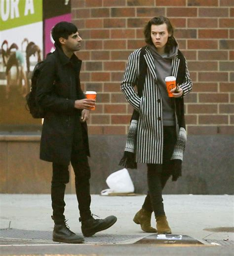 Harry Styles dons Beetlejuice stripy coat as he strolls ...
