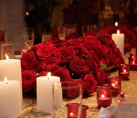 Red Roses Centerpiece With White Candles Flamenco