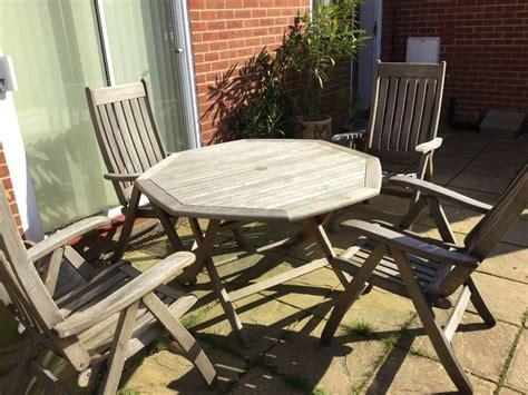 nova solid teak garden set consisting table