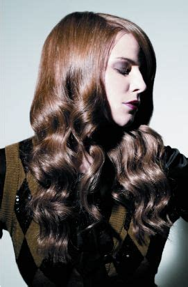 women curly hairstyle where part way down with the upper