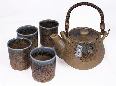 colored kitchen canisters pale blue and earthen crackled sand japanese tea set for four