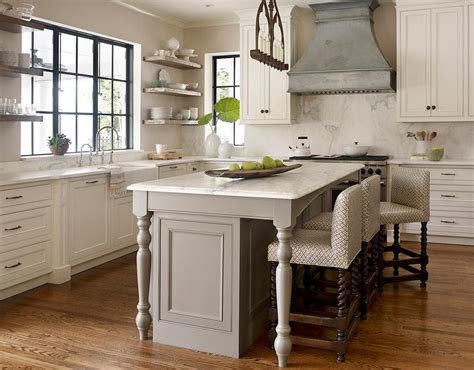 wooden kitchen island legs transitional kitchen features an iron linear chandelier