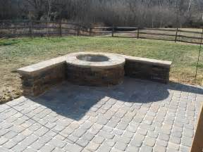 paver patio with stone firepit in charlotte by archadeck