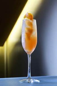 food and beverage photography mixed drink with orange peel ...