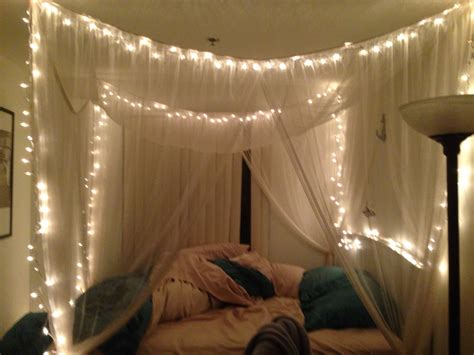 canap駸 lits twinkle lights in canopy bed this place your home