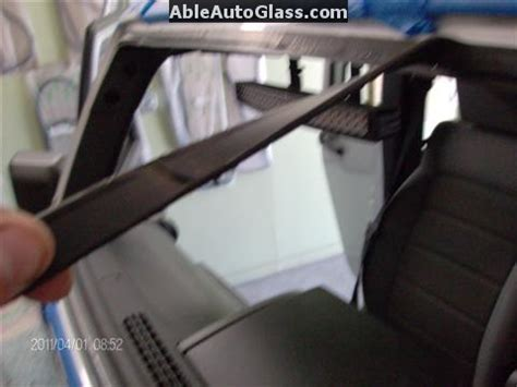 jeep wrangler   windshield replace  auto