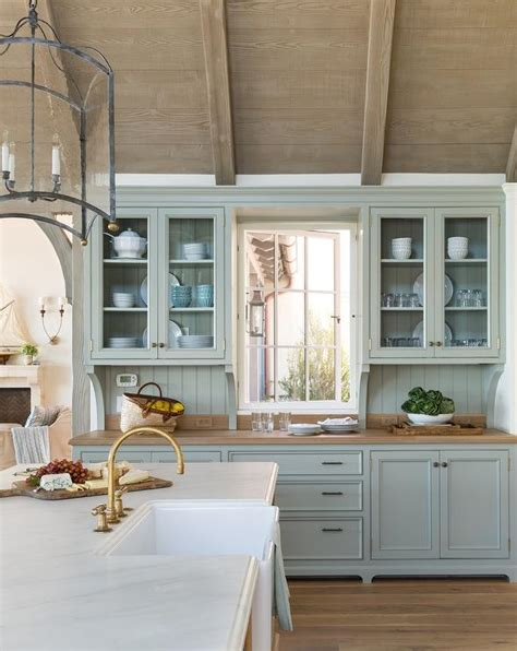 blue cottage kitchen cabinets  wood countertop