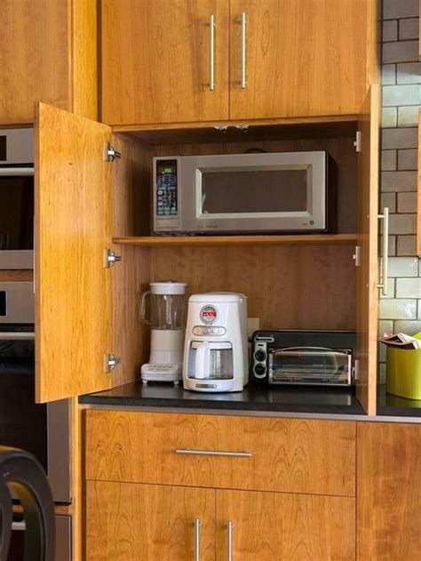 tucking small appliances  cabinets  organize