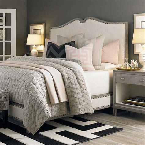 bedroom with grey upholstered headboard grey nightstands transitional bedroom