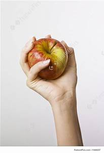 all fingers on fitness hand gripping apple stock picture i1688207 at featurepics