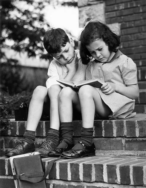 Young Boy & Girl Reading A Book Outdoors Photograph by