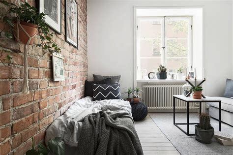 Tiny Studio Apartment With An Exposed Brick Wall