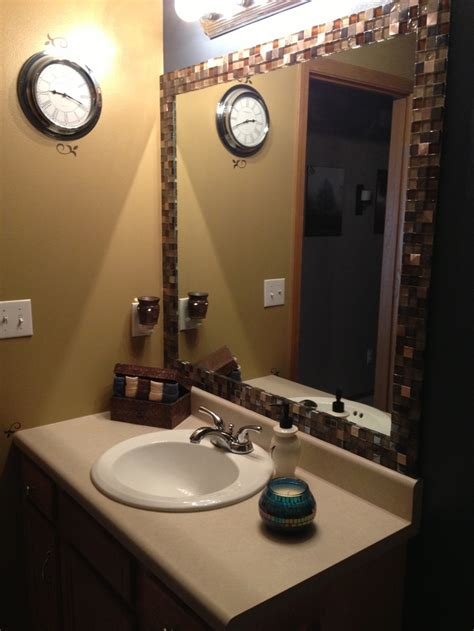 Bathroom Mirror Adhesive by Best 25 Tile Around Mirror Ideas On Tropical