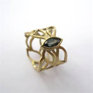 gold and green sapphire pierced ring contemporary rings