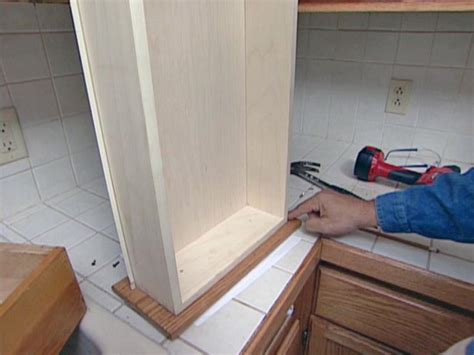 how to lay out kitchen cabinets how to reface and refinish kitchen cabinets how tos diy 8727
